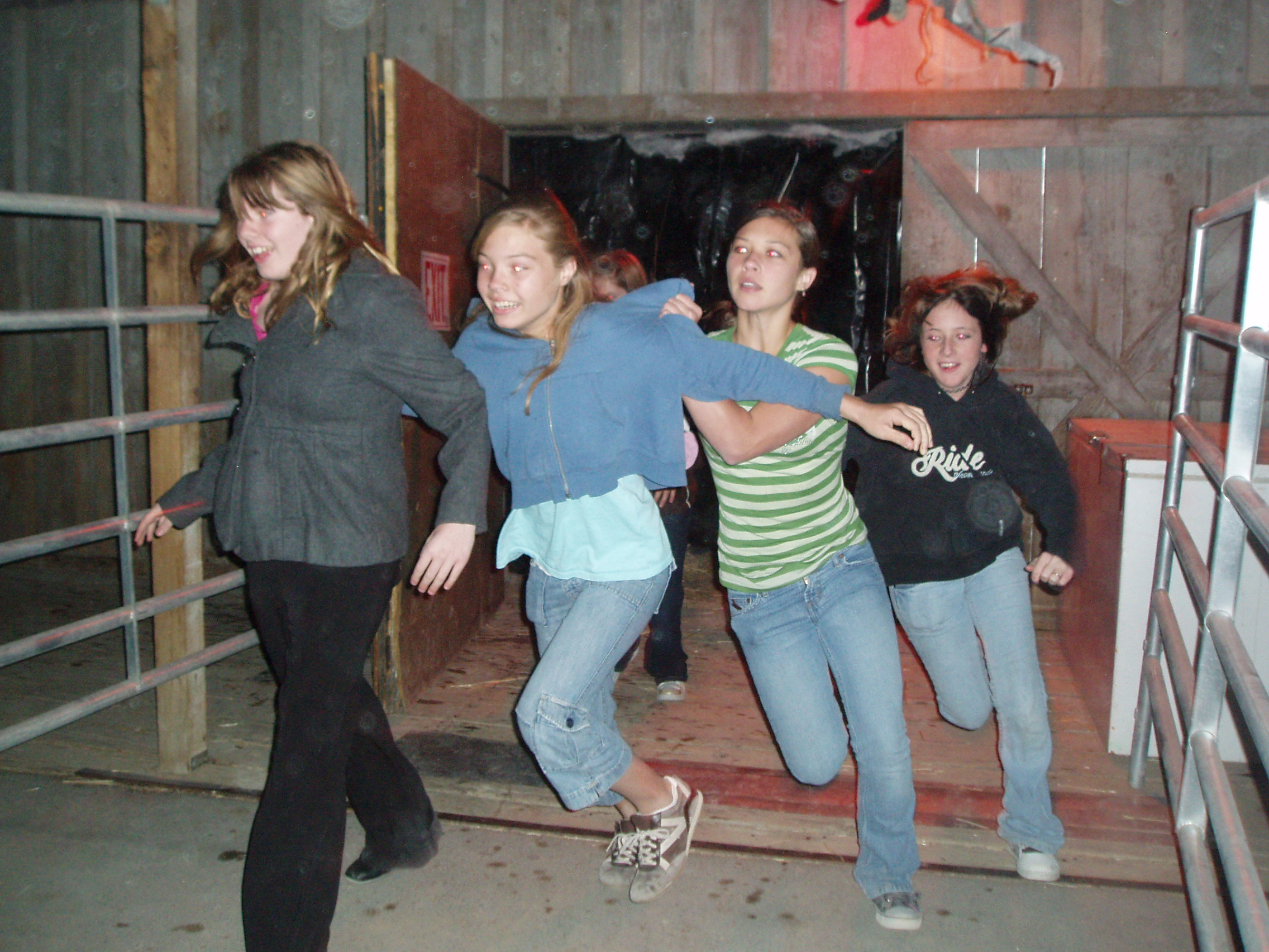 Group of Girls Run through Haunted House