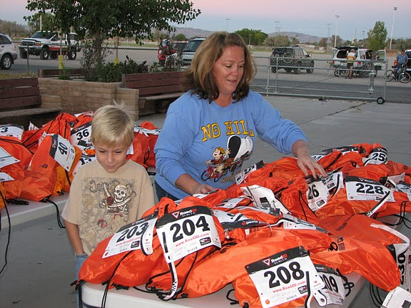 Woman and little boy volunteer to set up shirts and numbers for 5K