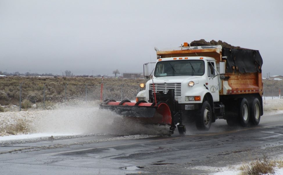 Road crew removes snow on a county road