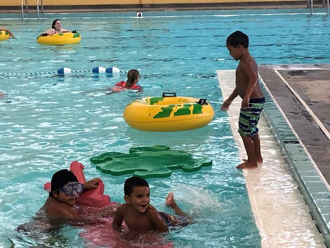 Children play in the county pool