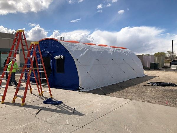 Triage tents go up behind Banner Churchill Hospital