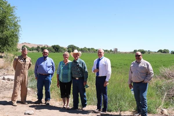 Navy, county reps flank Ernie and Carmen Schank in front of easement property